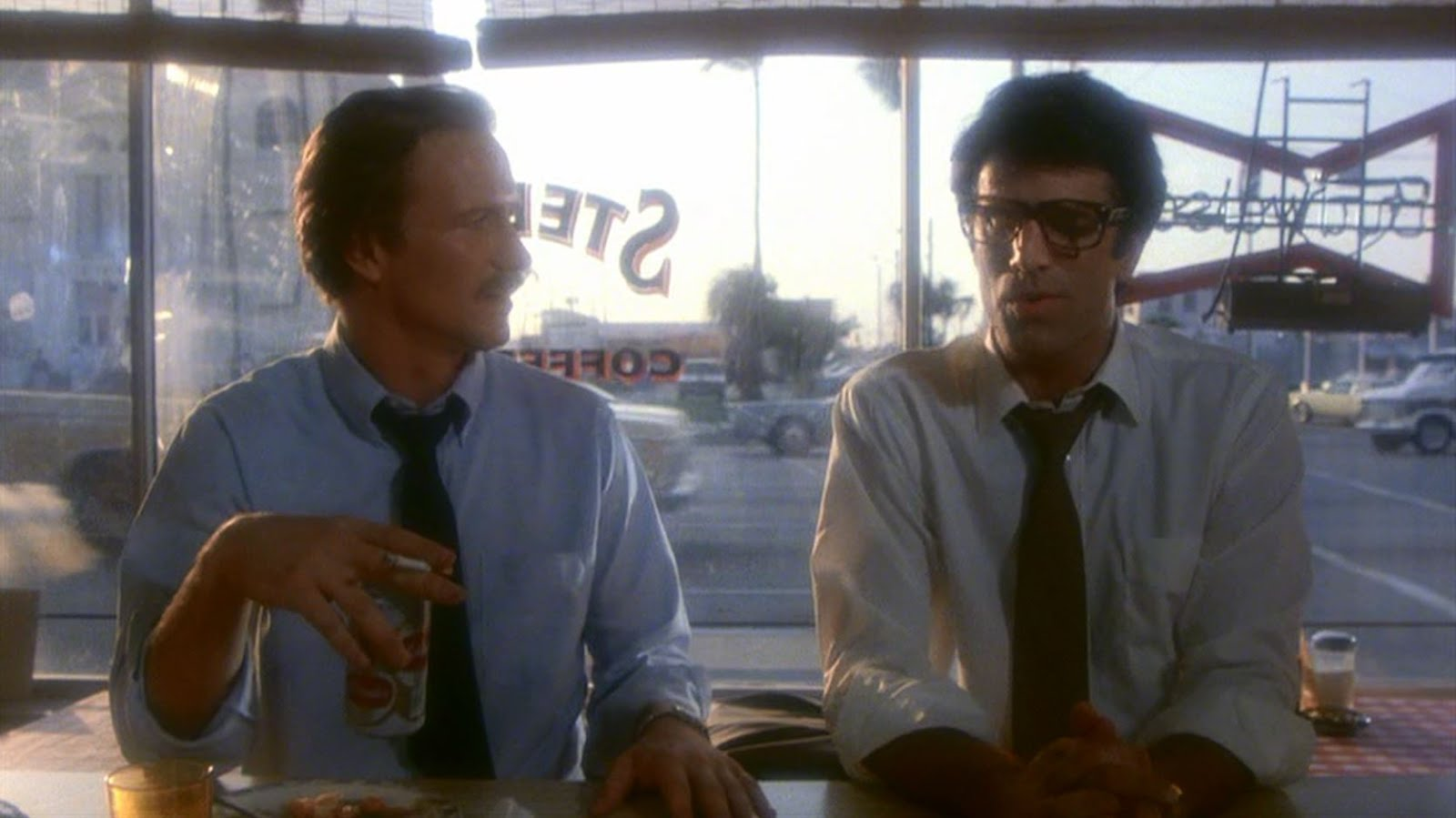 "A cold beer with lunch in ""Miranda Beach"", starring William Hurt and Ted Danson, 1981."