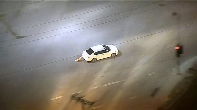 Brakes in the pursuit Car blaze red hot during the chase in L.A.