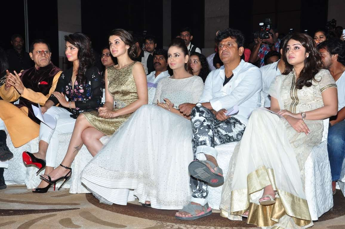 T Subbarami Reddy Shriya Saran Taapsee Pannu Parul Yadav Shivrajkumar and Nikita Thukral take in the proceedings during IIFA Utsavam  press meet