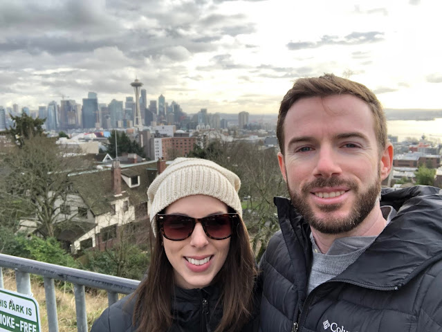 photo of me and Matt in front of the Seattle Space Needle