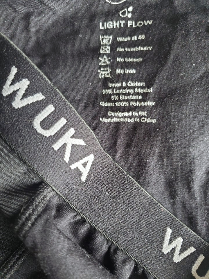 Wuka reusable period pants with washing instructions shown on inside printed label