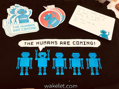 "Image of T-Shirt and stickers with Wakelet's slogan, ""The Humans are Coming!"""