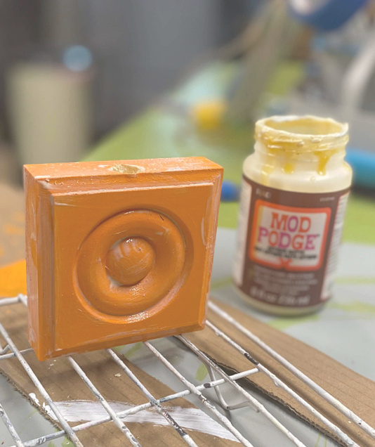 Mod Podge on corner molding pumpkins