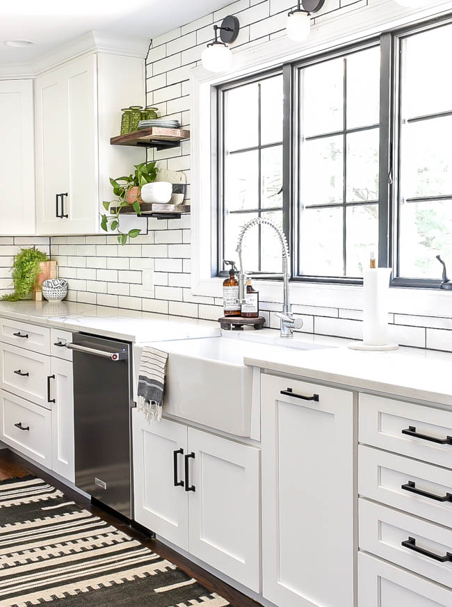 open shelves in kitchen with farmhouse sink