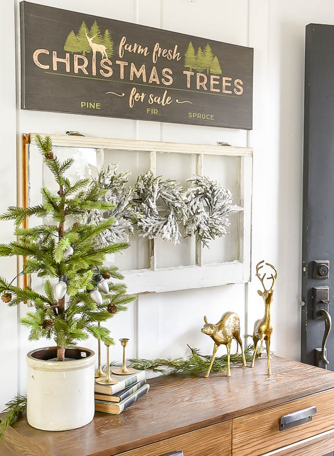 Neutral decorated Christmas entry table