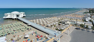 The beach at Senigallia, with its art nouveau pier and  pavilion, the Rotonda al Mare
