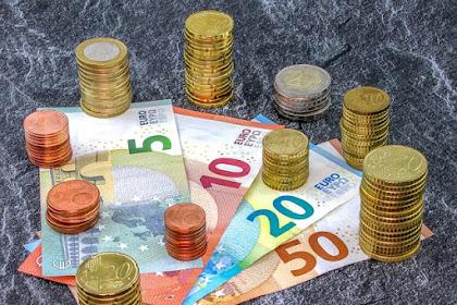 Menantikan Kepunahan Uang Kertas dan Uang Logam