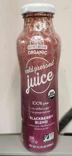A half-empty bottle of Nature's Nectar Organic Blackberry Blend Cold Pressed Juice