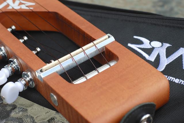 Risa Uke Solid ukulele bridge and saddle