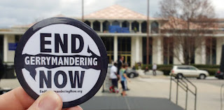 NC General Assembly building with close up of End Gerrymandering Now button