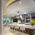 Espaço gourmet contemporâneo com bar, painel de tv em ônix e ilha em mármore!