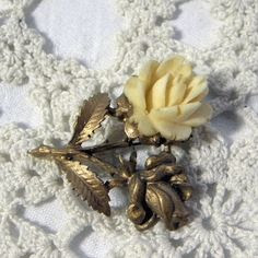 Rose brooch with bone detail by Exquisite