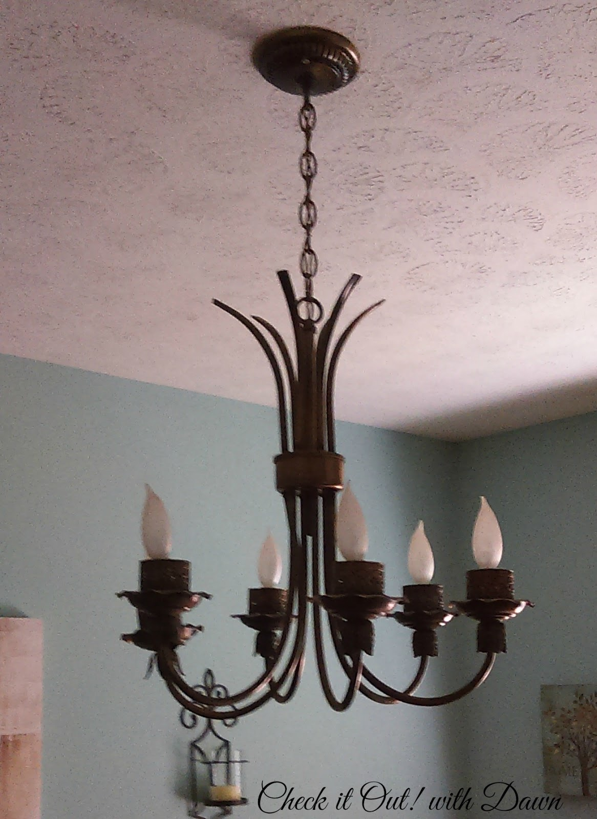 it out i have this really plain looking chandelier in my dining room