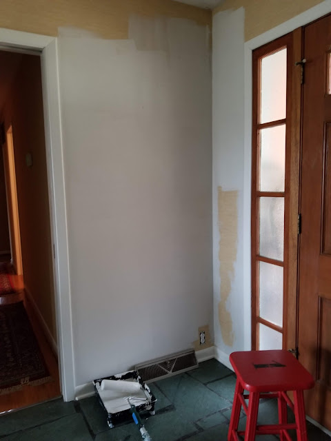 painting over wallpaper in entry