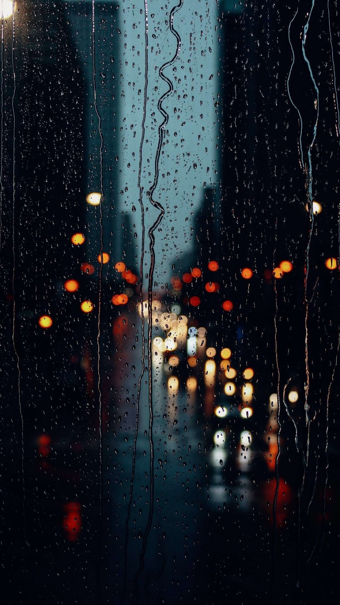 Rain drops on window glass mobile wallpaper