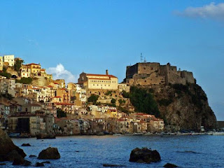 The ancient fishing village of Chianalea sits on the water's  edge in the shadow of the Castello Ruffo