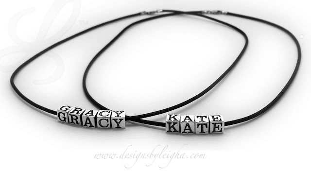 """Two necklaces are shown. Gracy has 5 sterling silver block letters (0 spacers) on a 16"""" leather and sterling silver necklace. Kate has 4 block letters (0 spacers) on a 16"""" leather necklace with a sterling silver lobster clasp."""