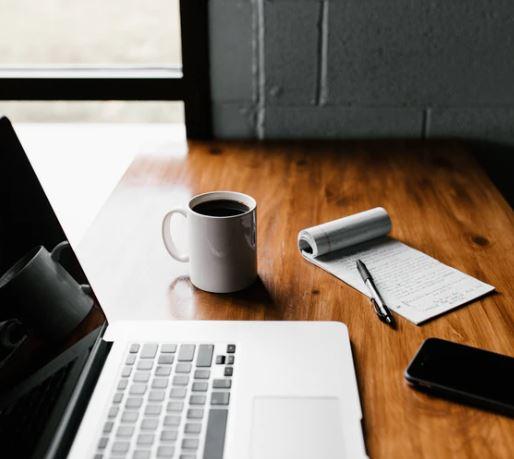laptop coffee phone notepad