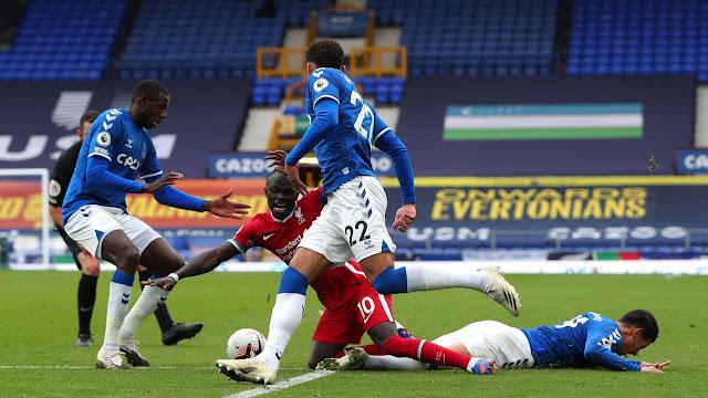 Everton players tackle Liverpool star Sadio Mane