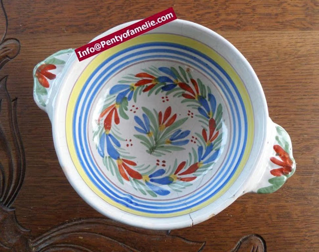 antique faience lug bowl.Floral design from artistic pottery of Malicorne located in France