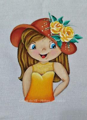 boneca amarela pintada em pano de copa