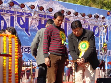GTA executive members Roshan Giri and Binay Tamang lighting the ceremonial lamp at the Krishi Mela in Jamuney on Monday.