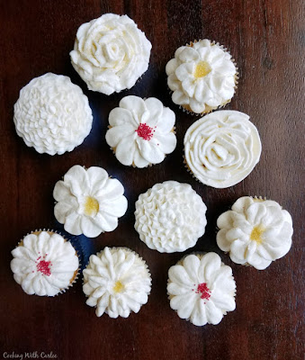 cupcakes with a variety of flower piped frosting patterns made from Italian meringue buttercream