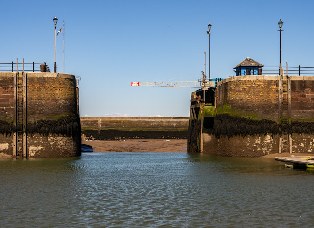 Photo of the marina gate open at low tide after the cable snapped