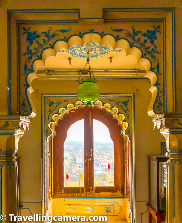 Above photograph shows one of the windows of Udaipur City Palace which is offering great views of the city from top. There are so many details in all these windows & doors of Udaipur City Palace. Paint designs, architectural shapes, complimenting wooden work, layers in the space and so many other elements to reflect royalty.