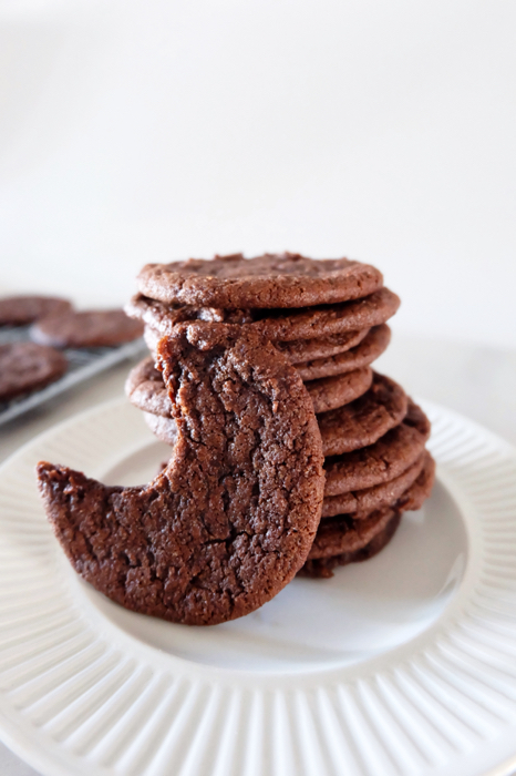 stacked chocolate wafer cookies on a plate