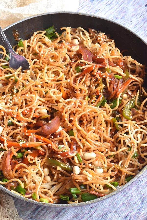 A bowl of Chinese noodle salad with carrots,capsicum,cabbage