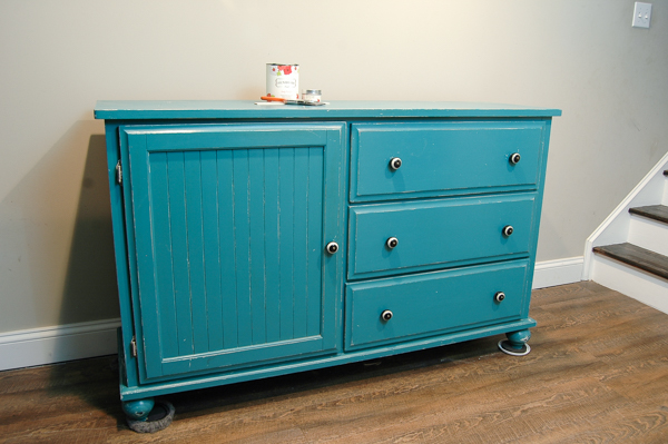 A $20.00 Goodwill dresser gets a major update with a few coats of paint and fun new knobs. www.littlehouseoffour.com