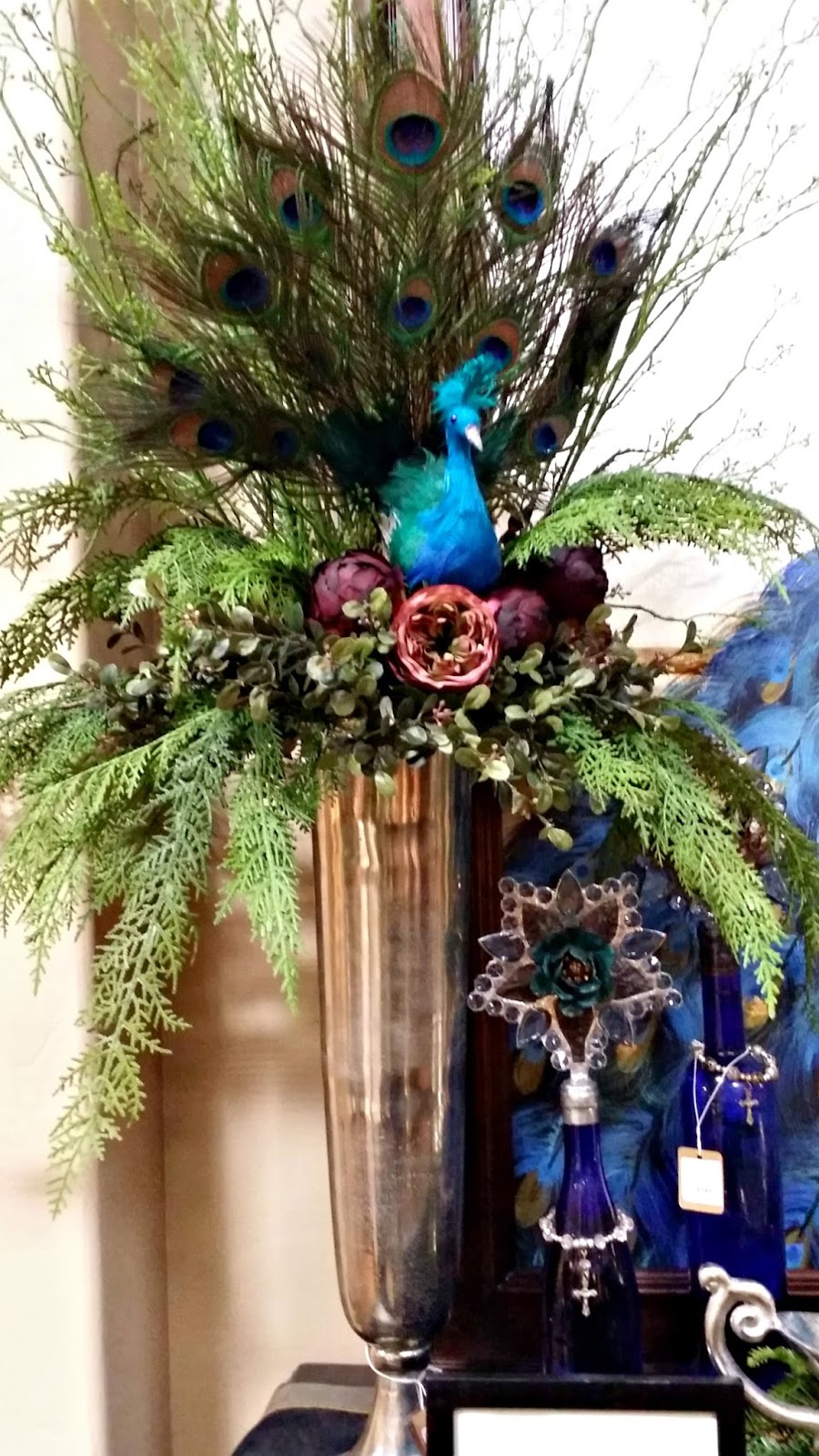 Decorating a floral with peacocks