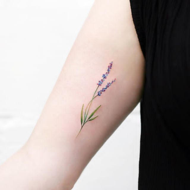 small lavender tattoo on hand
