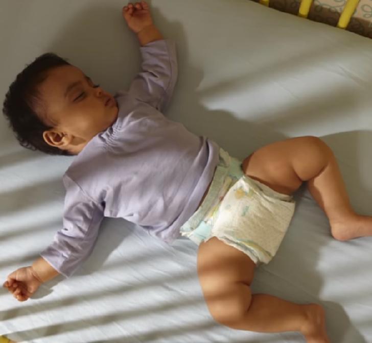 Kid wearing pampers diaper