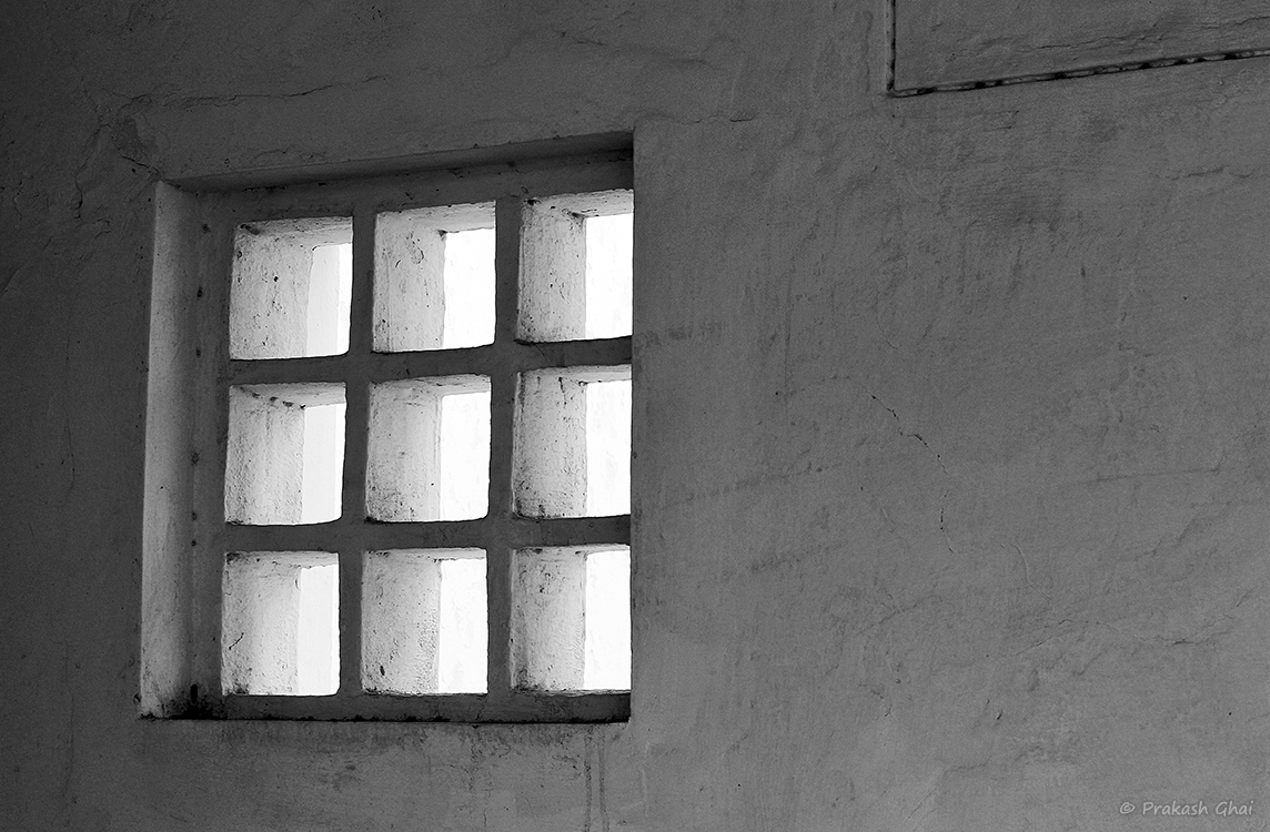 A Monochromatic Minimalist Photo of Nine Squares in Repetition within one a big Square.