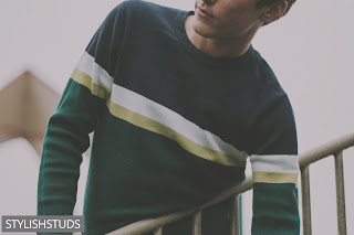A men wearing horizontal stripes crew neck sweater.