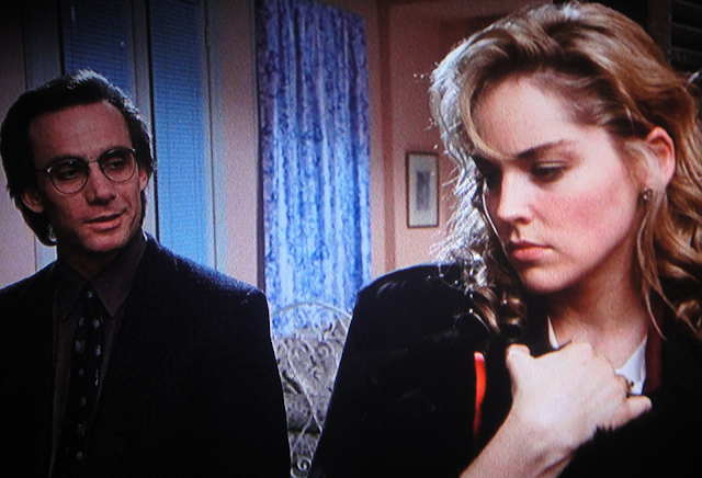 Angie (Sharon Stone) and Alex (Steve Railsback) in SCISSORS (1991)