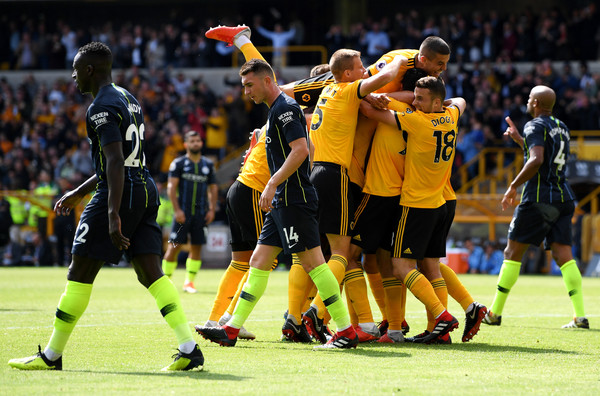 Willy Boly of Wolverhampton Wanderers celebrates after scoring his team's first goal with team mates during the Premier League match between Wolverhampton Wanderers and Manchester City at Molineux on August 25, 2018 in Wolverhampton, United Kingdom.