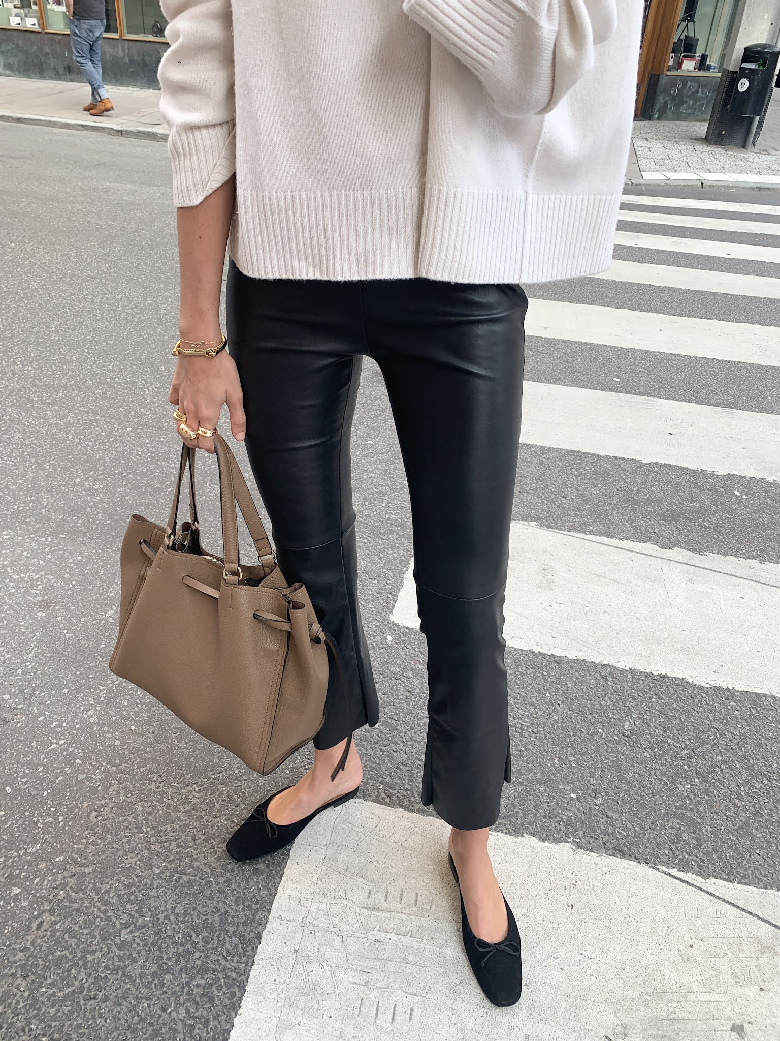 Best Black Flats — Fall outfit idea with a cream sweatre, leather pants, and Manolo Blahnik mule flats