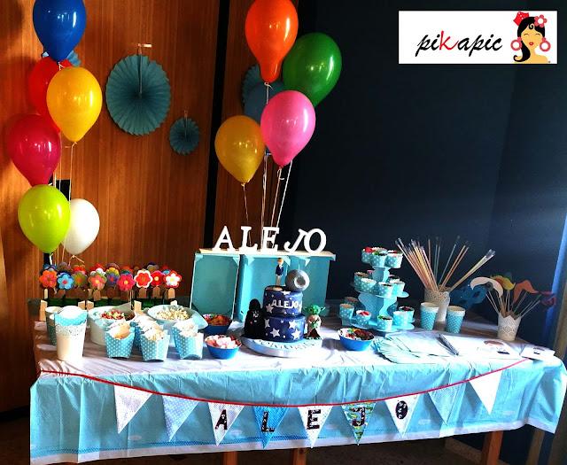 Mesa dulce con banderines decorativos. Alejo. Pikapic