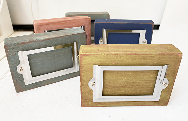 wooden signs with metal label holders