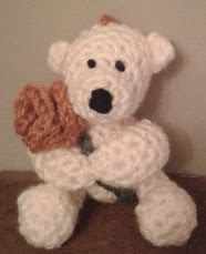http://www.ravelry.com/patterns/library/free-pattern---teddy-with-a-rose-keyring---valentine-bear