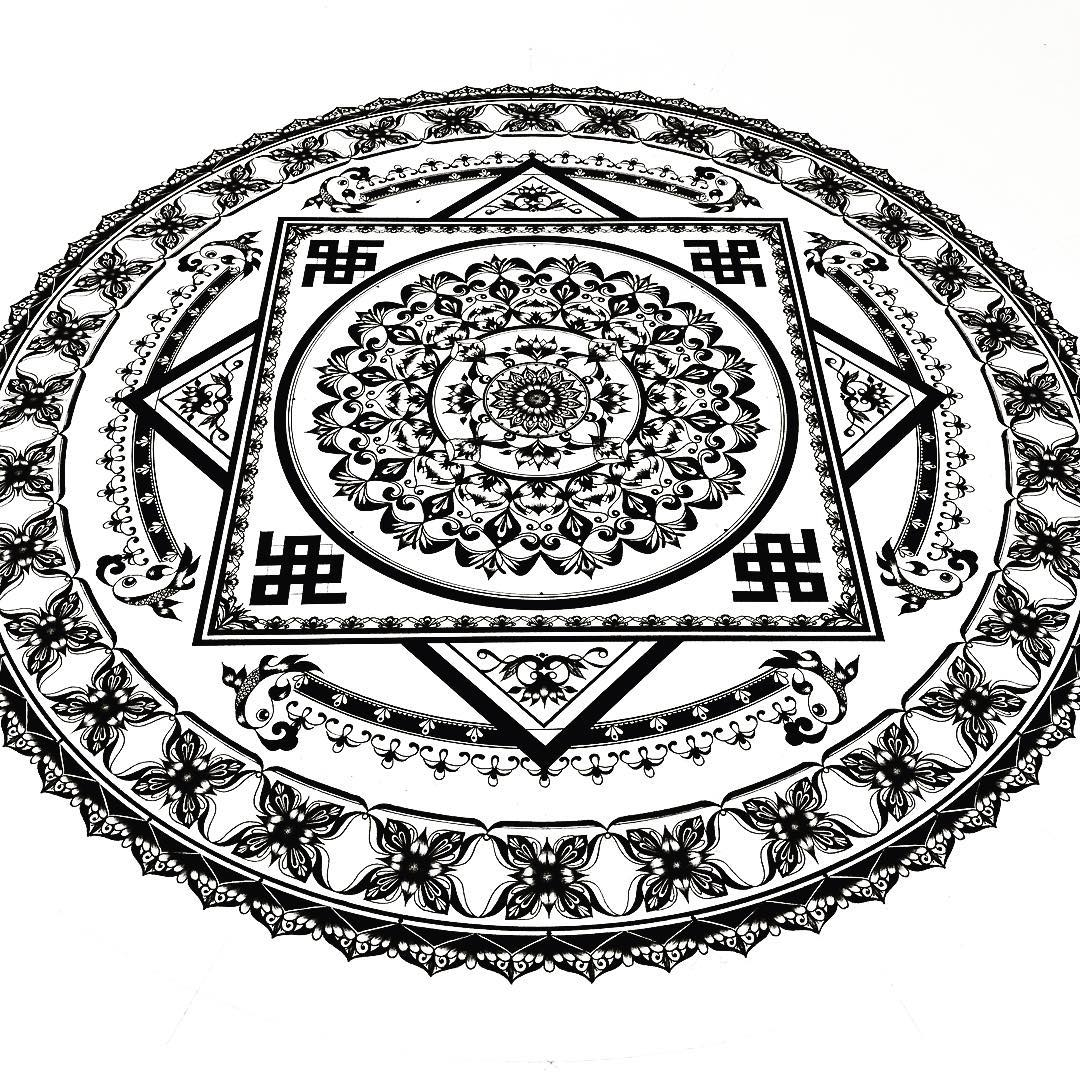 09-Eeling-Wong-Mandala-Drawings-Examples-of-Symmetry-and-Precision-www-designstack-co