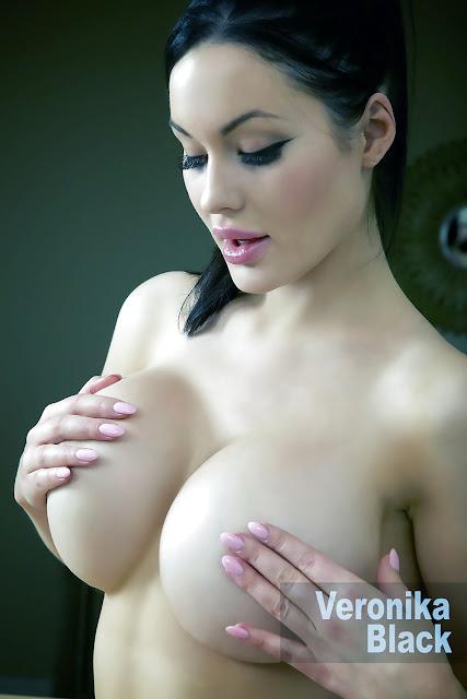 Veronika Black covering her nipples