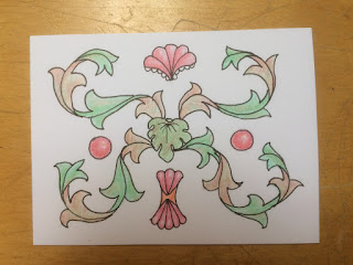 Acanthus scrolls on card colored with colored pencil