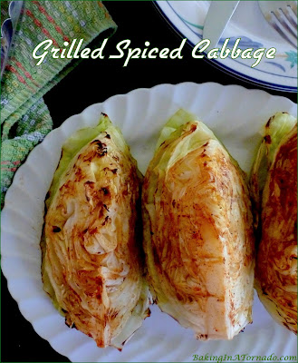 Grilled Spiced Cabbage is drizzled with a flavorful marinade and grilled. | Recipe developed by www.BakingInATornado.com | #recipe #dinner