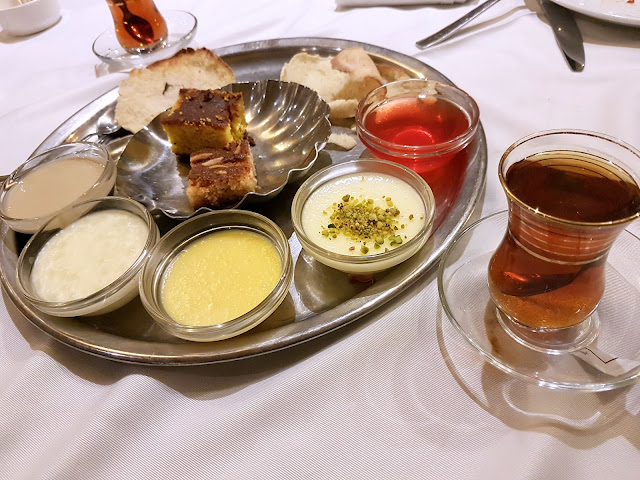 Dessert platter with tea with various puddings, custards and jello from Assaha, Kuwait
