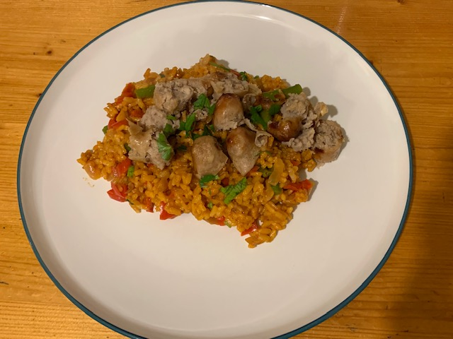 Caramelised onion sausages, with oven-baked tomato rice