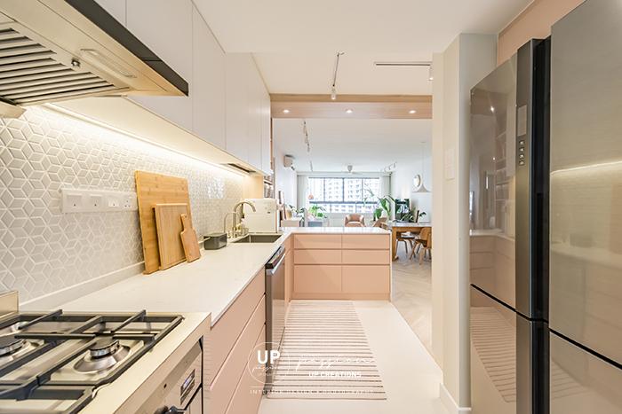 Mont Kiara Pines condo kitchen in a pastel pink, hexagon backsplash, white color top cabinet and white quartz top